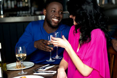 Affectionate romantic couple in a bar royalty free stock images