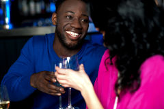 Affectionate romantic couple in a bar Stock Images