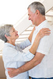 Affectionate senior couple dancing together Stock Photo