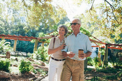 Affectionate senior couple enjoying a walk in the park Royalty Free Stock Image