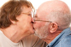 Affectionate Senior Couple Kissing. Isolated on a White Background Royalty Free Stock Photography