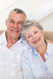 Affectionate senior couple smiling together Stock Image