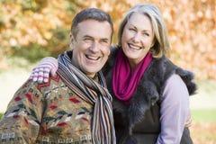 Affectionate senior couple on walk stock photography