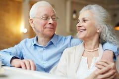 Affectionate seniors. Affectionate senior men embracing his wife Royalty Free Stock Photos