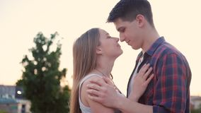 Affectionate sincere love couple kiss street. Affectionate and sincere couple embrace. Love expression. Young man and woman kiss in the street stock video