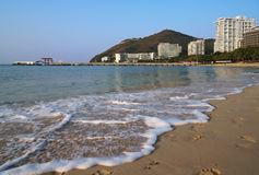 Affectionate South China Sea is washed by sand of Dadonghai Beach. Stock Images