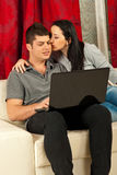Affectionate woman kiss her boyfriend Stock Photo
