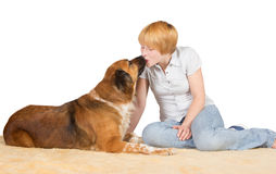 Affectionate woman kissing her dog Stock Images