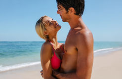 Affectionate young couple on the beach. Shot of affectionate young couple on the beach. Man and women embracing on the seashore royalty free stock photos