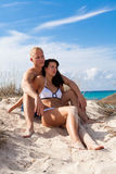 Affectionate young couple on the beach Royalty Free Stock Image