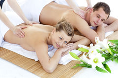 Affectionate young couple having a back massage Stock Images