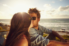 Affectionate young couple kissing at the beach Stock Photos