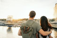 Affectionate young couple looking at the view of a harbor royalty free stock photography