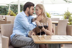 Affectionate young couple spending quality time at outdoor restaurant Stock Photography