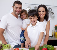 Affectionate young family cooking together Stock Photos