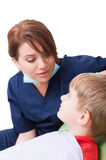 Affective female dentist with child patient Stock Photo