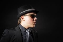Affective teenage boy dressed in strong suit Royalty Free Stock Photo