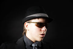Affective teenage boy dressed in strong suit Royalty Free Stock Photography