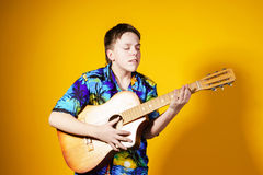 Affective teenage boy with guitar. Music concept. Stock Photo