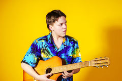 Affective teenage boy with guitar. Music concept. Royalty Free Stock Photography