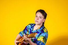 Affective teenage boy with guitar. Music concept. Royalty Free Stock Images
