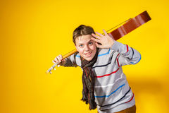Affective teenage boy with guitar. Music concept. Royalty Free Stock Image