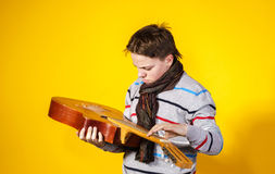 Affective teenage boy with guitar. Music concept. Stock Images