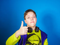 Affective teenage boy listening music in headphones Stock Photography