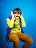 Affective teenage boy listening music in headphones Stock Image
