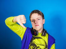 Affective teenage boy listening music in headphones Royalty Free Stock Images
