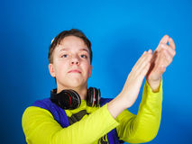 Affective teenage boy listening music in headphones Royalty Free Stock Photos