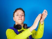 Affective teenage boy listening music in headphones Royalty Free Stock Photos