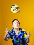 Affective teenage boy playing with ball Stock Image