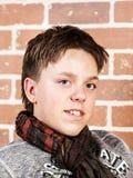 Affective teenage boy portrait in studio Stock Images