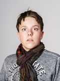Affective teenage boy portrait in studio Royalty Free Stock Images