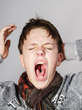 Affective teenage boy portrait in studio Stock Photos