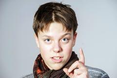 Affective teenage boy portrait in studio Stock Photo