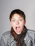 Affective teenage boy portrait in studio Stock Image