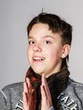 Affective teenage boy portrait in studio Royalty Free Stock Image