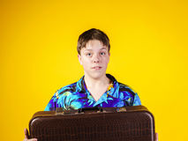 Affective teenage boy with retro suitcase Royalty Free Stock Image