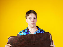 Affective teenage boy with retro suitcase Stock Image