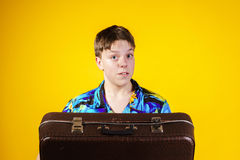 Affective teenage boy with retro suitcase Stock Image