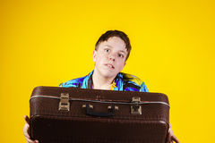 Affective teenage boy with retro suitcase Stock Images