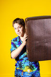 Affective teenage boy with retro suitcase Stock Photo
