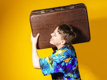 Affective teenage boy with retro suitcase Royalty Free Stock Photo