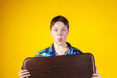 Affective teenage boy with retro suitcase Stock Photos