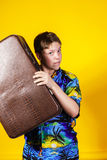 Affective teenage boy with retro suitcase Royalty Free Stock Images