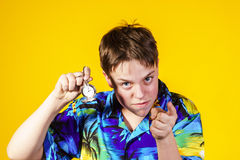 Affective teenage boy with watch showing time Royalty Free Stock Photo