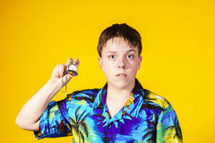 Affective teenage boy with watch showing time Royalty Free Stock Images