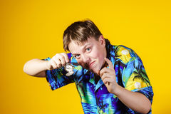Affective teenage boy with watch showing time Stock Photos